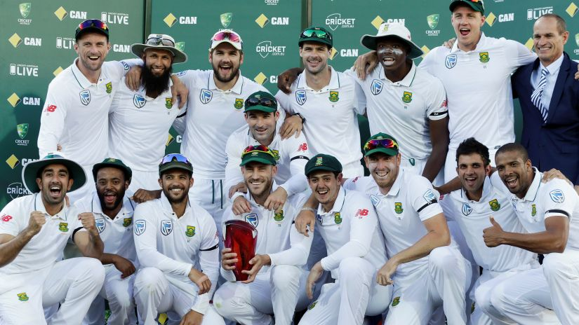 South Africa's captain Faf du Plessis holds the Test series trophy with teammates after defeating Australia in their 2016 series. Reuters