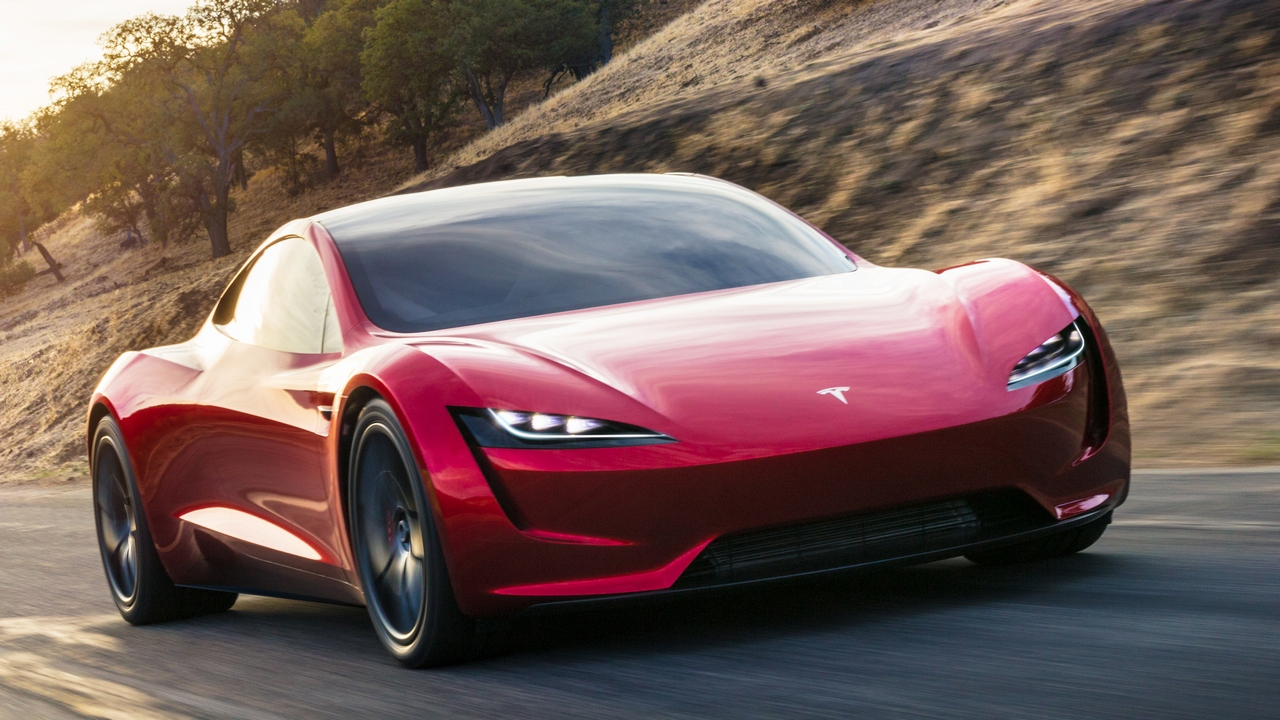 Elon Musk unveiled a prototype of the Tesla Roadster, a convertible which he claims will go from zero to 60 mph in a blistering 1.9 seconds and from zero to 100 mph in 4.2 seconds.