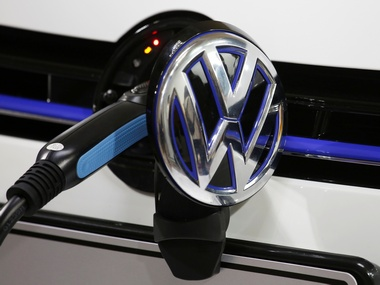 A Volkswagen Golf GTE is being charged during a workshop. Image: Reuters