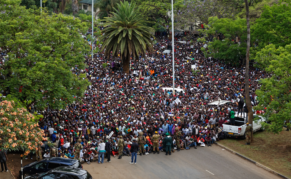 Thousands of Zimbabweans flood Harare's streets to celebrate imminent fall of Robert Mugabe