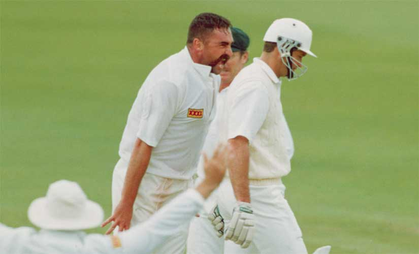 Merv Hughes (C) of Australia gives Graeme Hick of England a mouthful after dismissing him in the first Ashes Test at Old Trafford in 1993. Getty Images