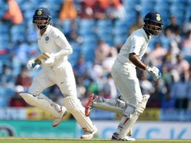India's Murali Vijay (L) and Cheteshwar Pujara run between the wickets during the Day 2 of the second Test against Sri Lanka in Nagpur. AFP