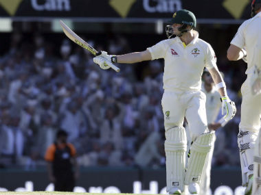 Australia skipper Steve Smith acknowledges the crowd after reaching his fifty in the Brisbane Test against Australia. AP