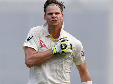Australia captain Steve Smith celebrates his 100 on Day 3 of the first Ashes Test. AFP