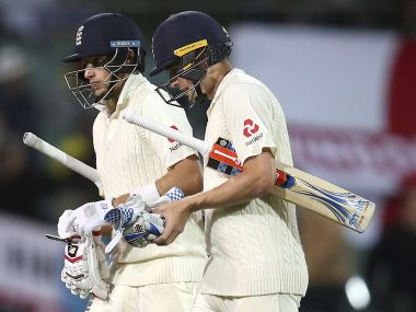 England's Joe Root, (left) and Chris Woakes walk off at stumps on the fourth day of the Adelaide Test. AP