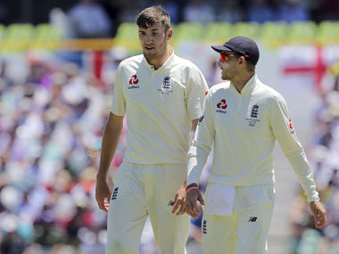 England's captain Joe Root, right, speaks to his owler Craig Overton during the third day of their Ashes cricket test match against Australia in Perth, Australia, Saturday, Dec. 16, 2017. (AP Photo/Trevor Collens)