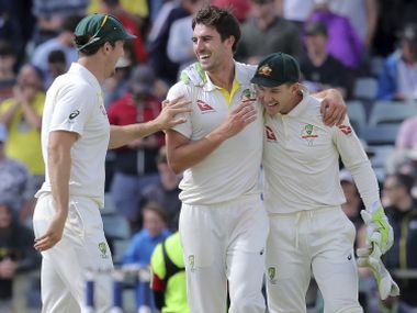 Australia's Mitchell Marsh, left, Pat Cummins and Tim Paine, right, winning the Ashes against England in Perth. AP