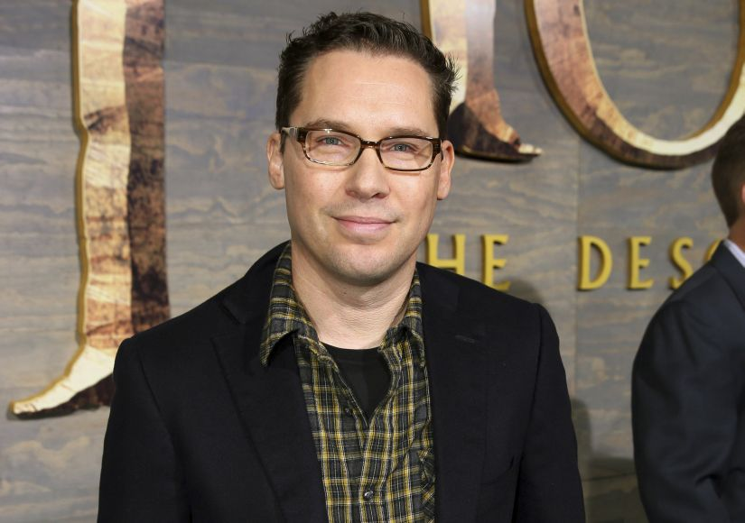 "FILE - This Dec. 2, 2013 file photo shows Bryan Singer at the Los Angeles premiere of ""The Hobbit: The Desolation of Smaug"" at the Dolby Theatre. Singer has left the Queen biopic ""Bohemian Rhapsody"" in the middle of production. A representative for Twentieth Century Fox Film Corp. said Monday, Dec. 4, 2017, that Singer is no longer the director of the film. (Photo by Matt Sayles/Invision/AP, File)"