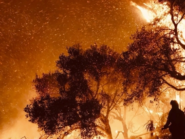 California wildfires rip through dry brush atop coastal ridge as firefighters struggle to check flames