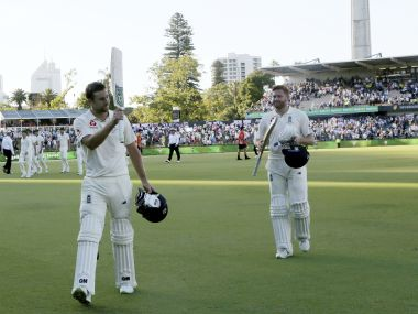 England's Dawid Malan, left, leaves the ground with teammate Jonny Bairstow at stumps on the first day of the third Ashes Test. AP