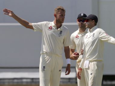 England captain Joe Root, right, talks with his bowlers Stuart Broad, left, and James Anderson, centre, during a Test match. AP