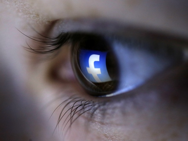 A picture illustration shows a Facebook logo reflected in a person's eye. Image: Reuters