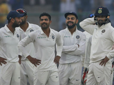 Indian players watch replay of the wicket of Sri Lanka's Suranga Lakmal on giant screen during the Day 4 of their third Test against Sri Lanka in Delhi. AP