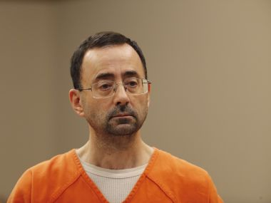 Larry Nassar, ex-USA Gymnastics doctor accused of sexually assaulting over 100 girls, jailed for 60 years for child porn