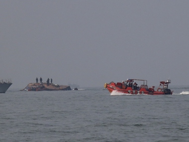 Fishing trawler capsizes in Bay of Bengal Indian Coast Guard recovers 14 bodies 4 fishermen reported missing