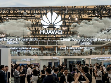 Visitors are seen at HUAWEI stand during the 2017 Mobile World Congress. Reuters