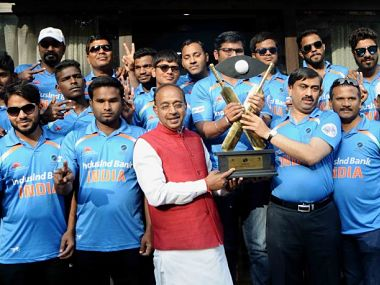 Players if India's blind cricket team felicitated by then Sports minister Vijay Goel. Image courtesy: CABI website