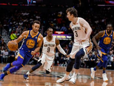 NBA: Stephen Curry injures ankle in Warriors' win over Pelicans; Cavaliers notch up 12th straight victory