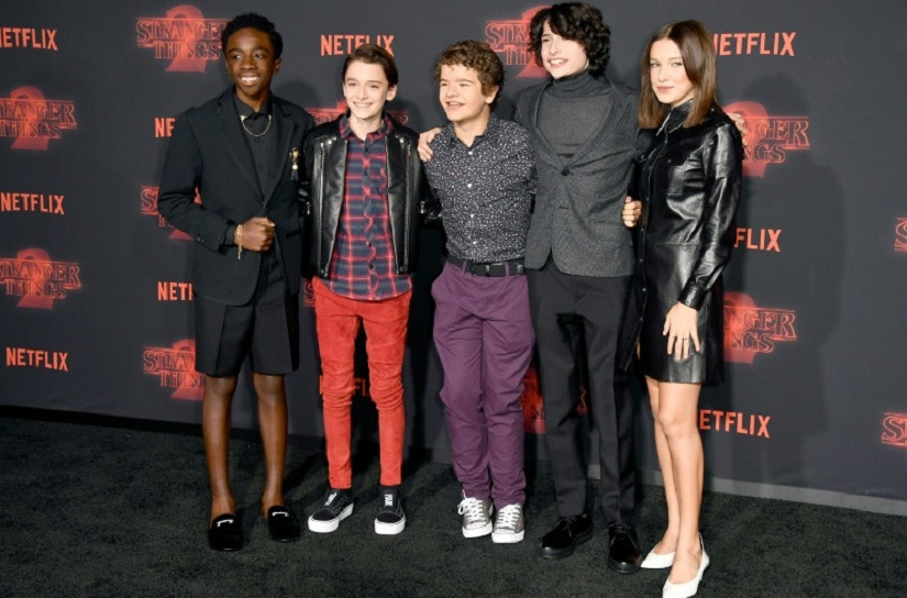 "The young stars of ""Stranger Things"" -- Caleb McLaughlin, Noah Schnapp, Gaten Matarazzo, Finn Wolfhard, and Millie Bobby Brown -- attend the season two premiere in October in Los Angeles. Image via AFP/Frazer Harrison"