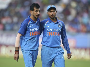India's Yuzvendra Chahal, left, and Kuldeep Yadav leave the ground at the end of Sri Lankan innings. AP