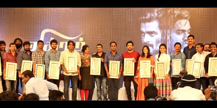 The cast and crew at the success meet. Image from Twitter/@PushkarGayatri