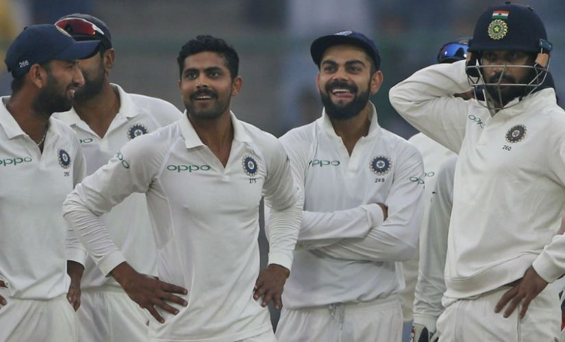 India players celebrate after a Sri Lanka wicket in the third Test. AP