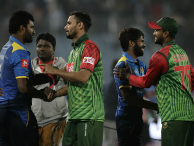Bangladesh players shake hands with their Sri Lanka counterparts. AP