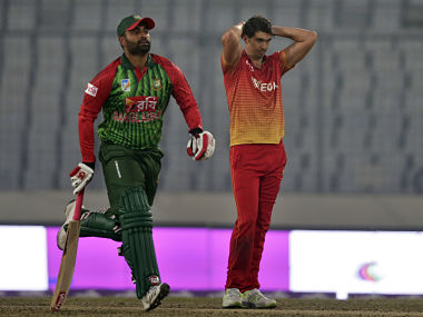 Zimbabwe's captain Graeme Cremer, right, reacts as Bangladesh's Tamim Iqbal runs between the wickets during the first match of their Tri-Nation one-day international cricket series in Dhaka, Bangladesh, Monday, Jan. 15, 2018. (AP Photo/A.M. Ahad)