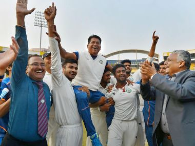 Vidarbha players celebrate with their coach Chandrakant Pandit after winning the Ranji Trophy final cricket match against Delhi by 9 wickets, in Indore on Monday. PTI