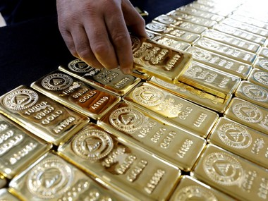 Gold inches up as US stimulus package to combat virus stems rush for cash strong dollar restricts further gains for yellow metal