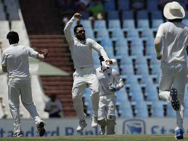 India's captain Virat Kohli, center, celebrates with bowler Jasprit Bumrah, left, for dismissing South Africa's batsman Aiden Markram, for 1 run during the third day of the second cricket test match between South Africa and India at Centurion Park in Pretoria, South Africa, Monday, Jan. 15, 2018. (AP Photo/Themba Hadebe)