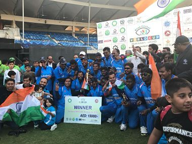 India's players pose with the trophy after beating Pakistan in the Blind World Cup final. Image courtesy: Twitter @DDNewsLive