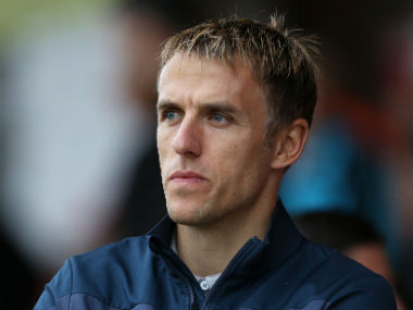New England womens football coach Phil Neville caught in sexist tweet row