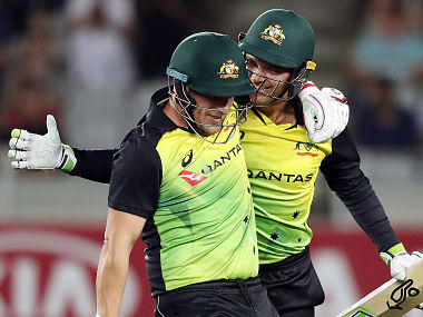 Australia's Alex Carey (R) and Aaron Finch (L) celebrate the win during the Twenty20 Tri Series international cricket match between New Zealand and Australia at Eden Park in Auckland on February 18, 2018 / AFP PHOTO / MICHAEL BRADLEY