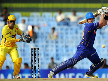 RESTRICTED TO EDITORIAL USE. MOBILE USE WITHIN NEWS PACKAGE Rajasthan Royals batsman Shane Watson (R) is watched by Chennai Super Kings wicketkeeper Mahendra Singh Dhoni as he plays a shot during the IPL Twenty20 cricket match between Chennai Super Kings and Rajasthan Royals at The M.A. Chidambaram Stadium in Chennai on May 4, 2011. AFP PHOTO/ Dibyangshu SARKAR / AFP PHOTO / DIBYANGSHU SARKAR