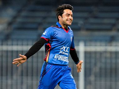 (FILES) This file photo taken on December 10, 2017 shows Afghanistan's Rashid Khan celebrating the wicket of Ireland's Niall O'Brien during the third one-day international (ODI) cricket match between Afghanistan and Ireland at Sharjah Cricket Association Stadium in Sharjah. Many of the world's top cricketers, including Khan, will be sold to the highest bidder when the Indian Premier League holds its annual auction on January 27-28, 2018. / AFP PHOTO / NEZAR BALOUT