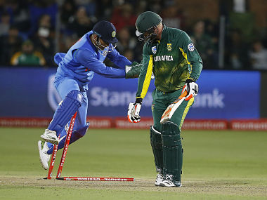 South African batsman Heinrich Klaasen (R) reacts after being stumped by Indian wicketkeeper Mahendra Singh Dhoni (L) during the fifth one day international (ODI) cricket match between South Africa and India at St. George Park in Port Elizabeth on February 13, 2018. / AFP PHOTO / MARCO LONGARI