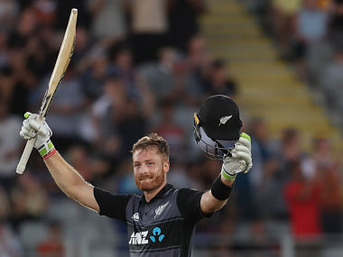 New Zealand's Martin Guptill celebrates his century during the Twenty20 Tri Series international cricket match between New Zealand and Australia at Eden Park in Auckland on February 18, 2018 / AFP PHOTO / MICHAEL BRADLEY