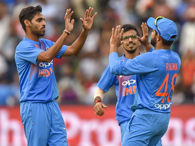 India's Suresh Raina celebrates with teammate Bhuvneshwar Kumar after taking a catch to dismiss unseen South African batsman Chris Morris. AFP