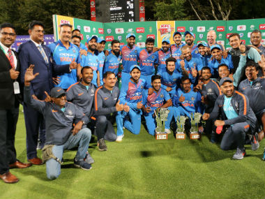 The victorious Indian team and support staff pose with the winner's trophy. Image credit: Twitter/@ICC