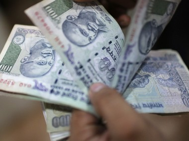Rupee reverses gains to close nearly flat at 7171 rising crude oil prices foreign fund outflows weigh on currency