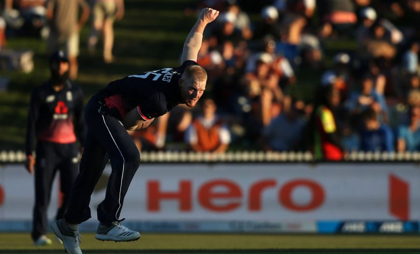 England's Ben Stokes bowls during the first ODI against New Zealand at Seddon Park in Hamilton on 25 February. AFP