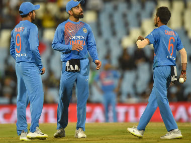 India captain Virat Kohli speaks to Yuzvendra Chahal (R) during the 2nd T20I of the series against South Africa in Centurion. AFP