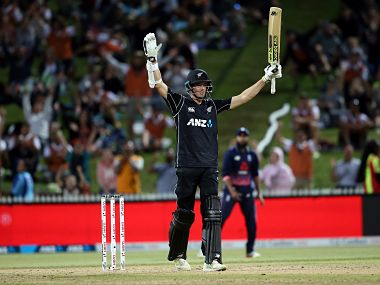 New Zealand's Mitchell Santner celebrates hitting the winning runs during the first ODI against England. AFP