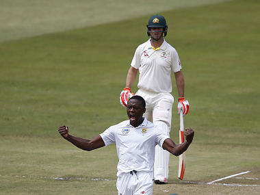 South African bowler Kagiso Rabada (C) celebrates after taking the wicket of unseen Australian batsman Tim Paine during play on the second day two of the first Test cricket match between South Africa and Australia at The Kingsmead Stadium in Durban on March 2, 2018. / AFP PHOTO / MARCO LONGARI