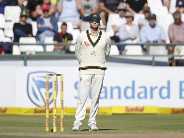Australian Captain Steven Smith stands by stumps during the fourth day of the third Test cricket match between South Africa and Australia at Newlands cricket ground on March 25, 2018 in Cape Town. / AFP PHOTO / GIANLUIGI GUERCIA