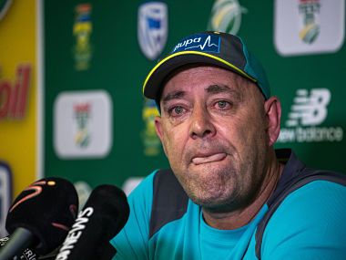 Darren Lehmann speaks to the press as he announces he will resign as Australian cricket coach after the coming Test match on March 29, 2018 in Johannesburg. / AFP PHOTO / WIKUS DE WET