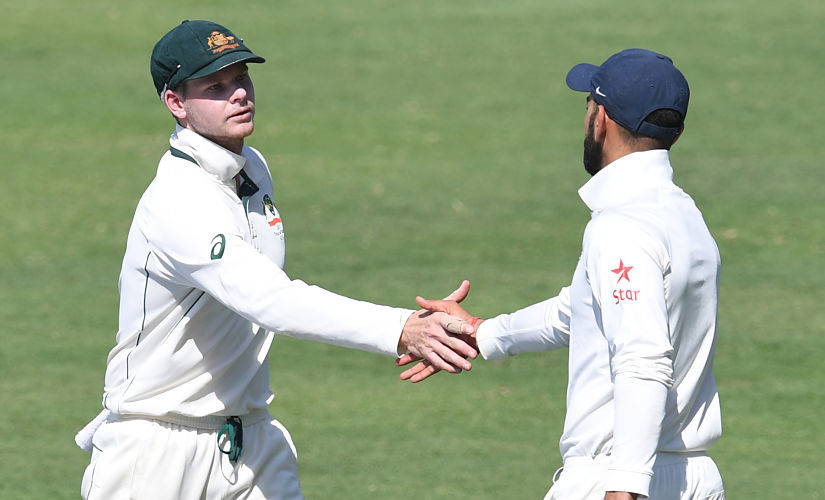 Australia's captain Steve Smith (L) greets India's captain Virat Kohli after winning the first cricket Test match between India and Australia at The Maharashtra Cricket Association Stadium in Pune on February 25, 2017. ----IMAGE RESTRICTED TO EDITORIAL USE - STRICTLY NO COMMERCIAL USE----- / GETTYOUT / AFP PHOTO / INDRANIL MUKHERJEE / ----IMAGE RESTRICTED TO EDITORIAL USE - STRICTLY NO COMMERCIAL USE----- / GETTYOUT