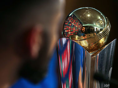 India's cricket captain, Virat Kohli is reflected in the trophy as he addresses a press conference in The Grange in London on May 25, 2017, ahead of the ICC Champions Trophy 2017 tournament to be held from June 1 - 18. / AFP PHOTO / Daniel Leal-Olivas