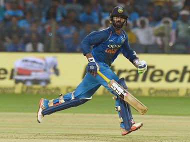 Indian cricketer Dinesh Karthik runs between the wickets during the second ODI cricket match between India and New Zealand at The Maharashtra Cricket Association Stadium in Pune on October 25, 2017. / AFP PHOTO / INDRANIL MUKHERJEE / ----IMAGE RESTRICTED TO EDITORIAL USE - STRICTLY NO COMMERCIAL USE----- / GETTYOUT